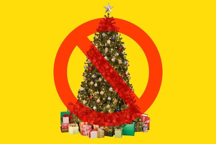 Christmas Tree on yellow background with cancel sign over it