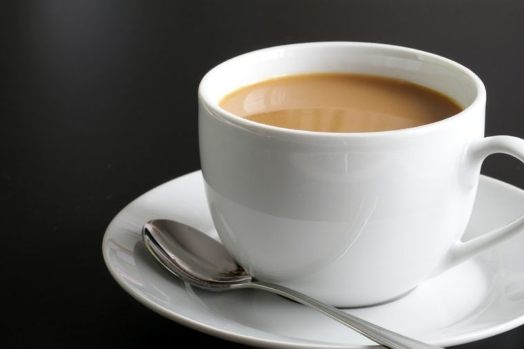cup of coffee and black copyspace for text message