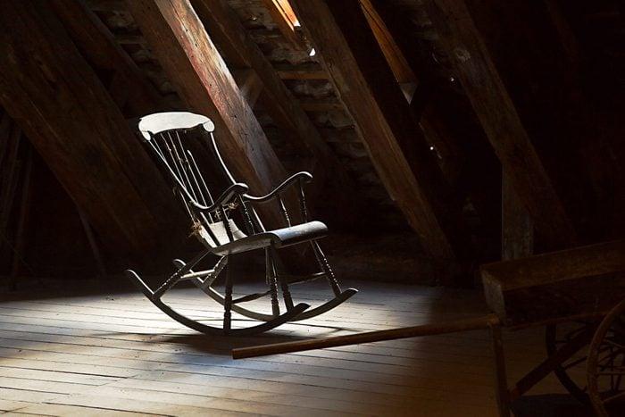 Old rocking chair on a dim attic