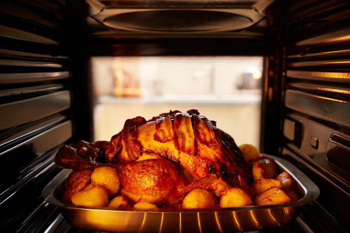 Thanksgiving Turkey Roasting Inside Oven