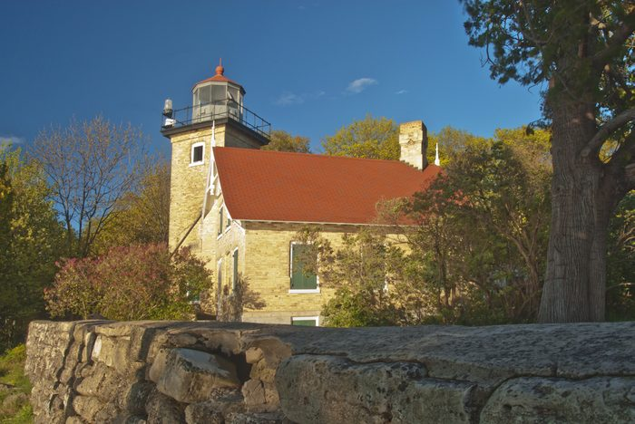 The Eagle Bluff Lighthouse overlooks the waters of Green Bay in Lake Michigan. Today the lighthouse is located in Peninsula State Park, Door County, Wisconsin