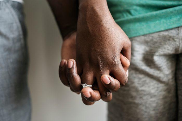 Couple holding hands closeup