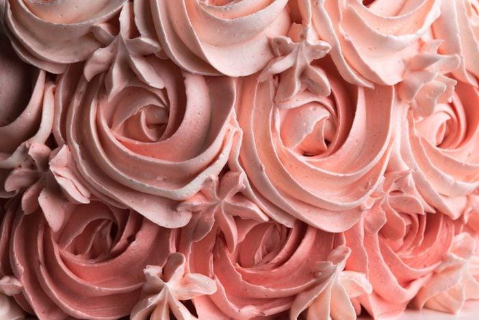 Rose cake icing swirl decoration background pattern. Horizontal.