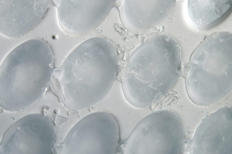 Ice cube building in ice cube tray for background or texture