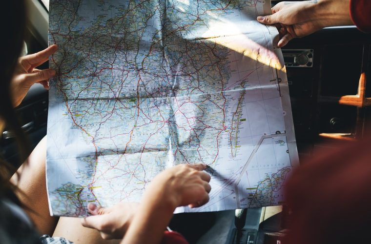 Friends Reading Map Traveling Destination Camping Concept
