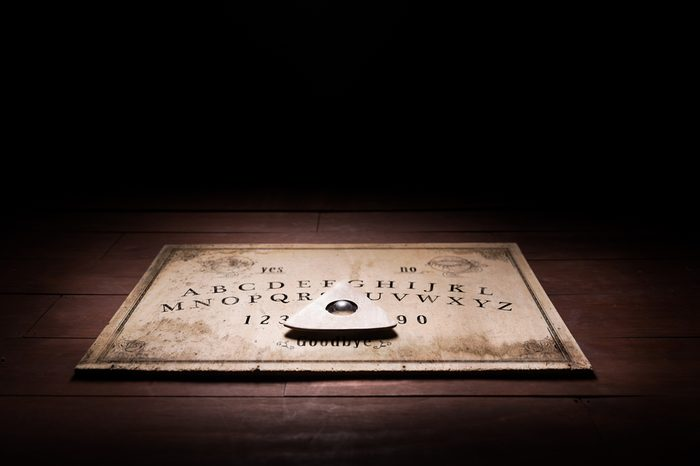 Talking board and planchette used on seances for communicating with the dead / high contrast image