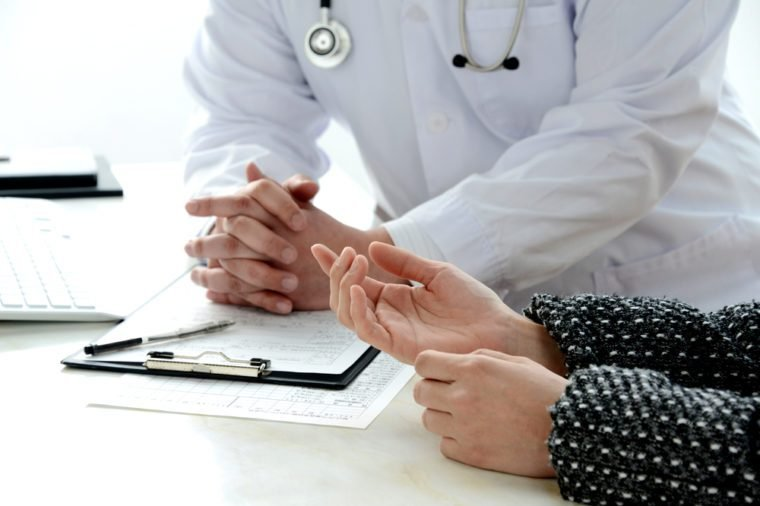 Patient's hand explaining for doctor