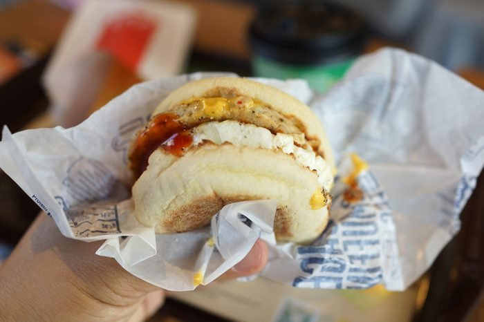 PENANG, MALAYSIA - MAY 25, 2018 : Egg McMuffin with McDonald Premium Roast Coffee is one of the meals choice at McDonald's Weekday Breakfast Specials.