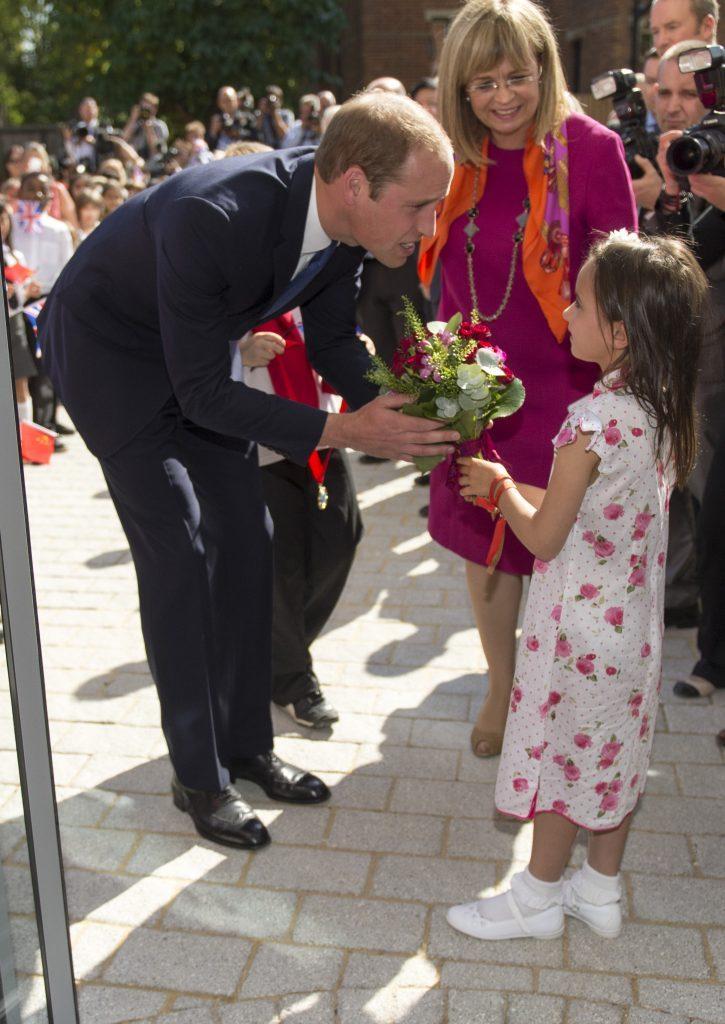 Prince William receiving flowers