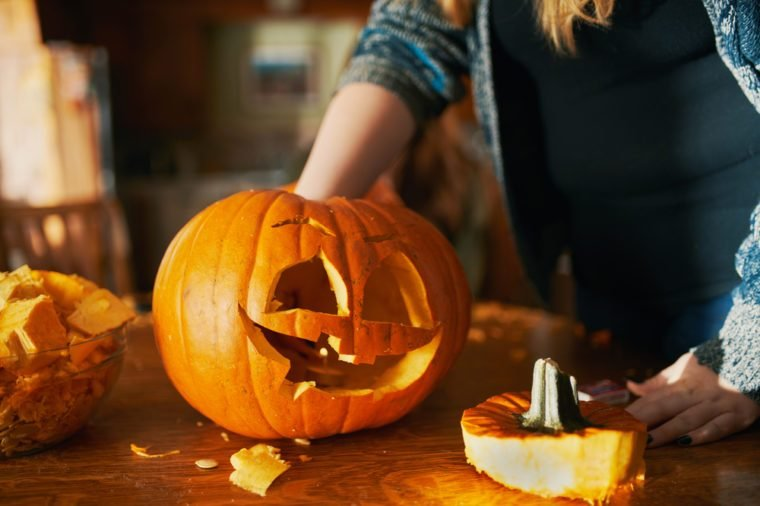 family fun activity - carved pumpkins into jack-o-lanterns for halloween close up