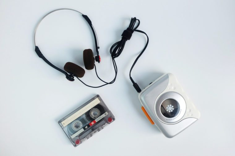 Retro cassette tape and Portable tape player with radio on white floor, top view