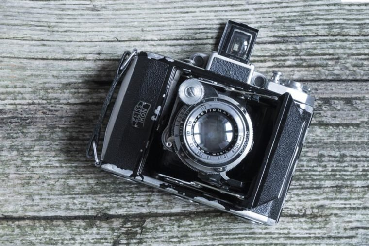 Milan/Italy - October 20, 2016: Vintage photo camera, a Zeiss Ikon Super Ikonta 530, built in 1934, on wooden background