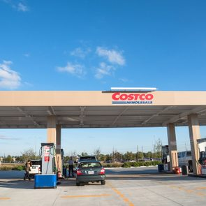HUMBLE, TEXAS, US-NOV 23, 2016: Costco gas station with customers refueling. Costco Wholesale Corporation is largest membership-only warehouse club in US. It has a total of 705 warehouses worldwide.