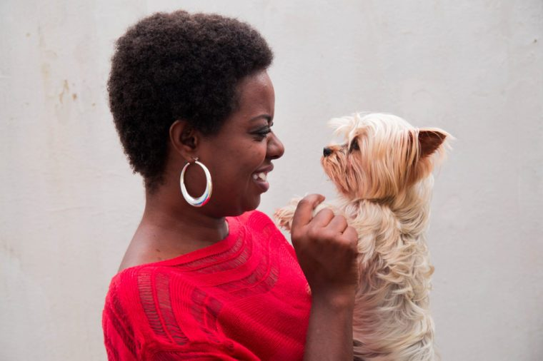 black woman holding a yorkshire dog