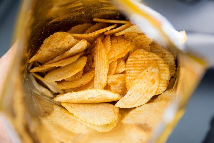 Potato chips is snack in bag ready to eat and fat food or junk food., Potato Chips in a Ready-to-Eat Bag.