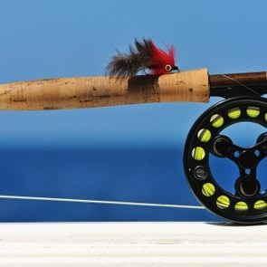 Close up shot of saltwater fly fishing tackle against sea