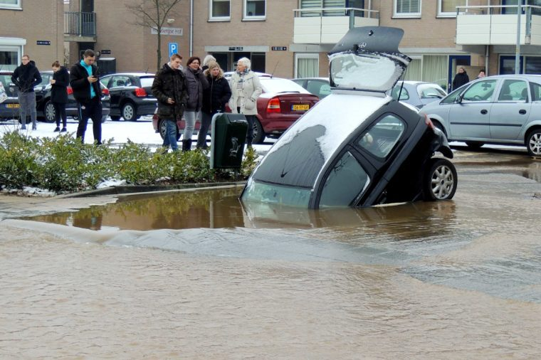 Sinkhole swallows a car in Wijchen, The Netherlands - 02 Mar 2018