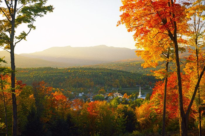 Overlooking a peaceful New England community church and village in the autumn., Stowe, Vermont, USA