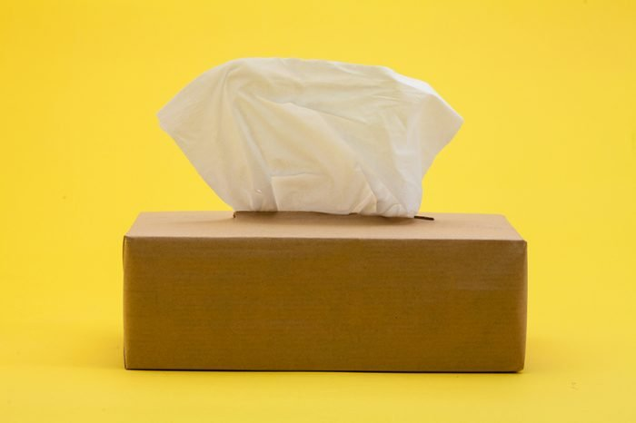 Paper tissues in brown box on yellow background