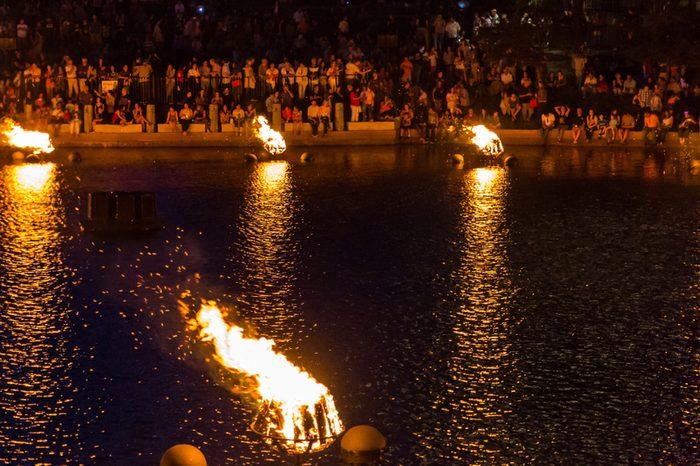 Crowds enjoy WaterFire display.