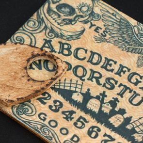 Wooden Board Ouija: Communication with Spirits, Religion Theme.