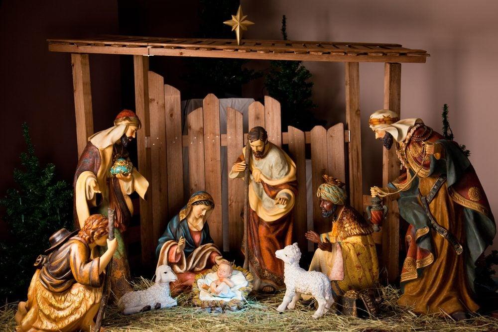 Christmas Manger scene with figurines including Jesus, Mary, Joseph, sheep and magi.
