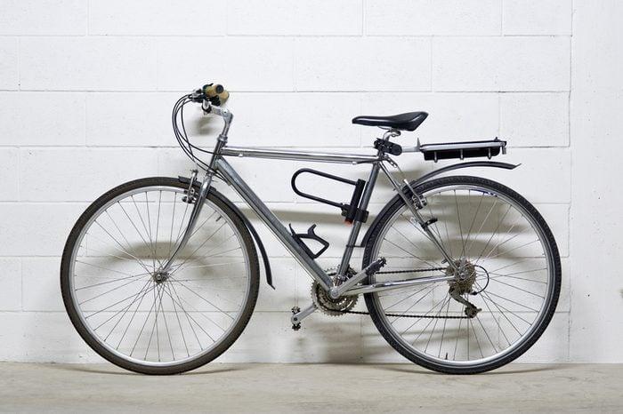 City bike over white wall.