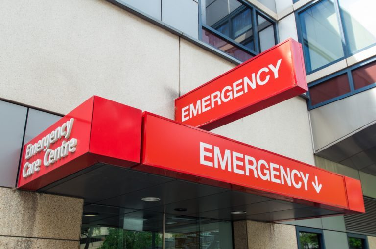 Entrance to and signage for a hospital emergency department in Melbourne, Australia