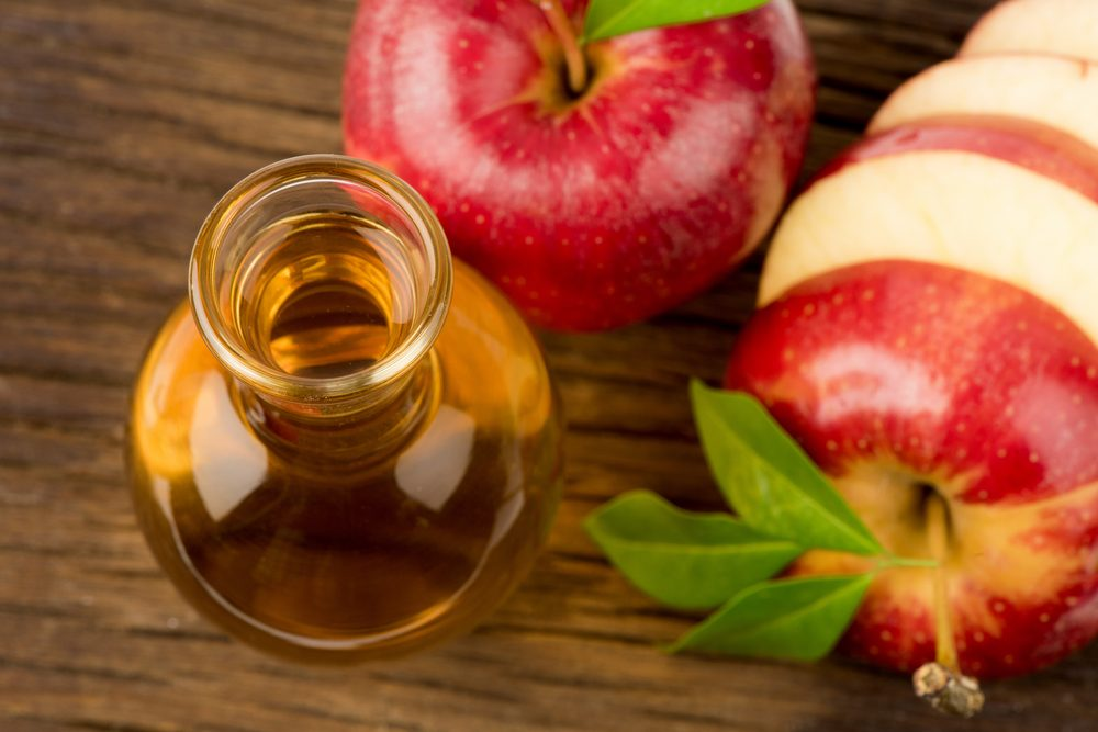 Red apple and Apple Cider Vinegar.