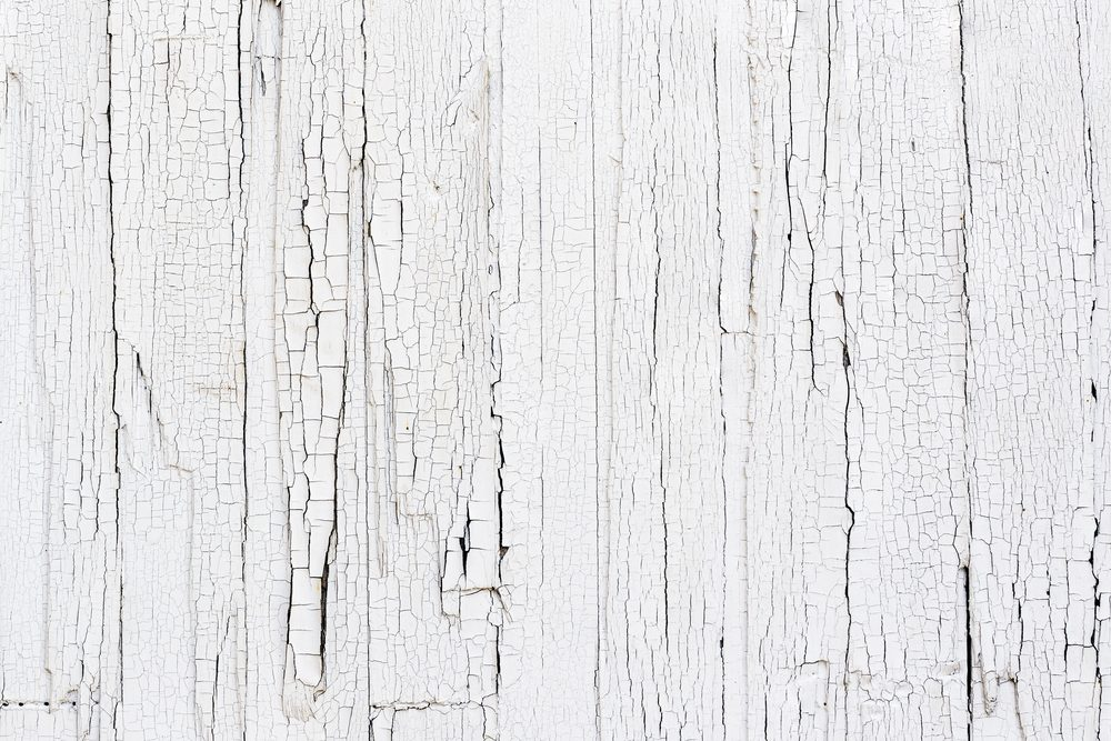 Close Up of Chipped White Paint on an Exterior Wood Wall