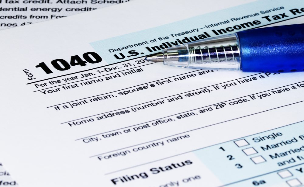 1040 Tax Return Form with a Pen