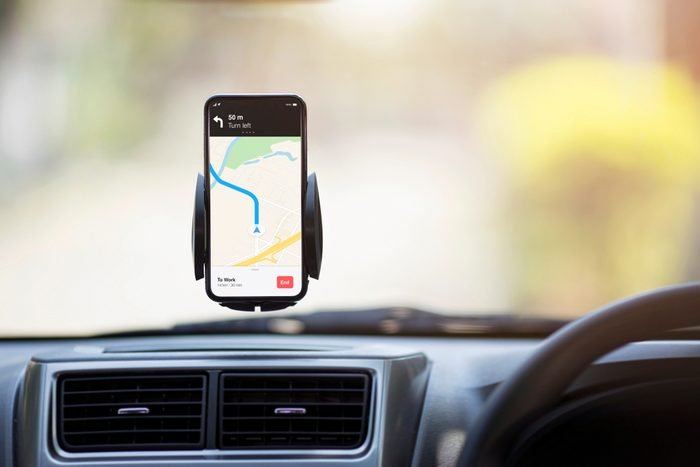 Mobile Phone with Map GPS Navigation in Car