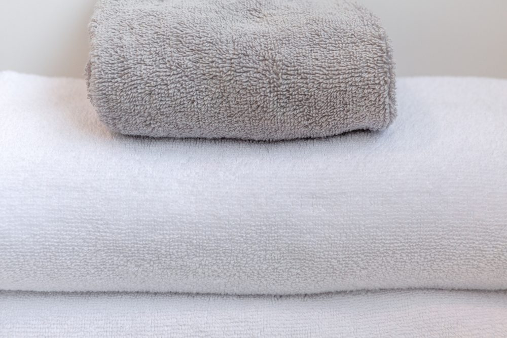 White and gray folded towels extreme closeup