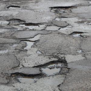 deep potholes in the road make driving hazardous