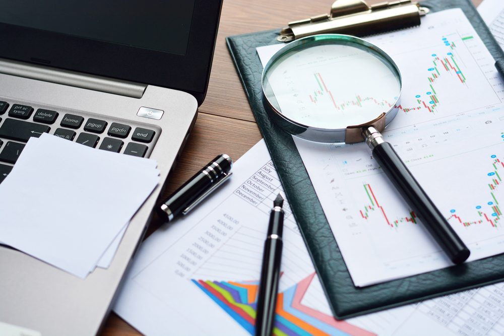 Financial printed paper charts, graphs and diagrams