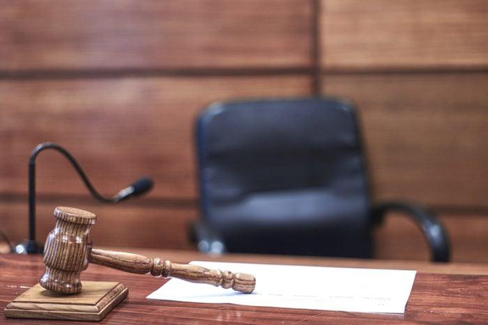Judge hammer on a dais