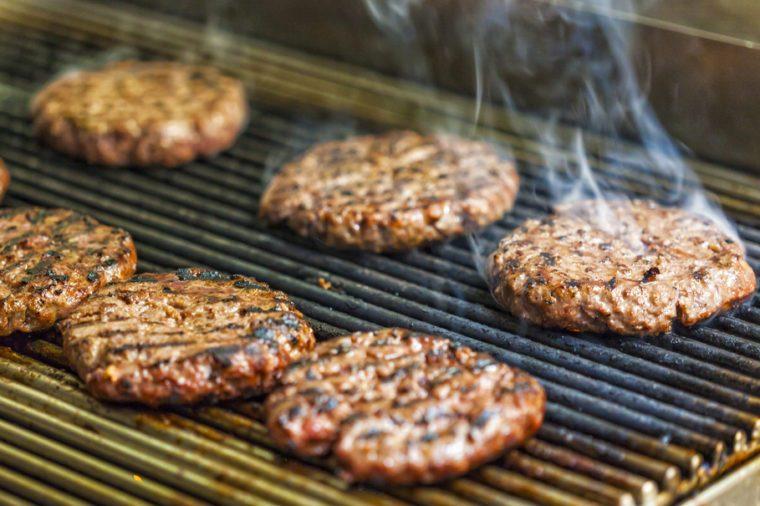 Preparing hamburgers on a grill