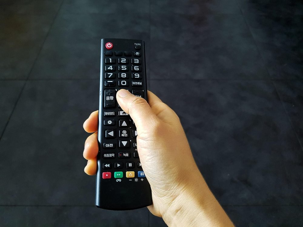 Woman hand remote control