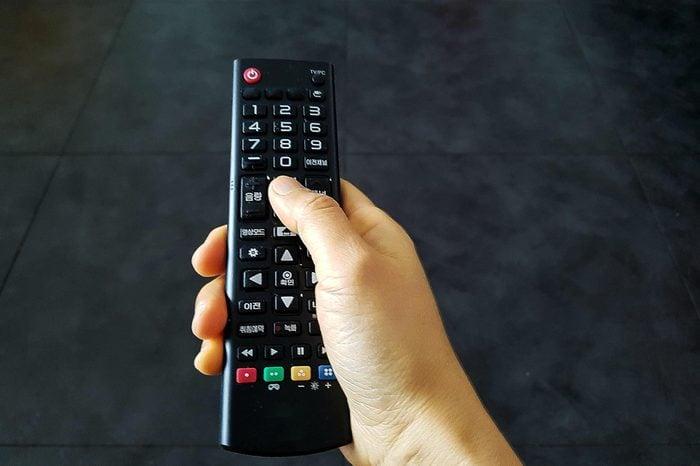 Woman hand remote control