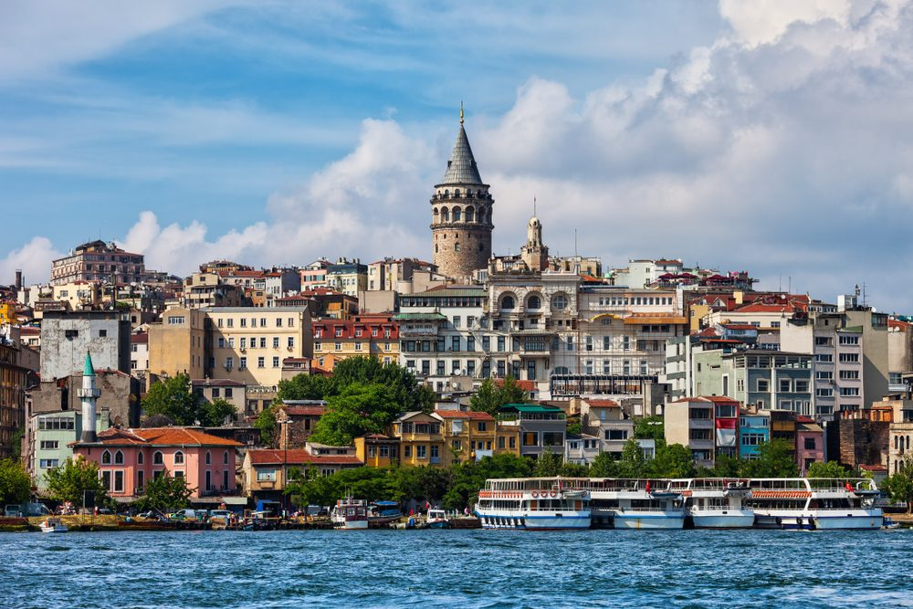 Istanbul city skyline in Turkey, view from Golden Horn, houses in Beyoglu district with Galata tower in the midlle.