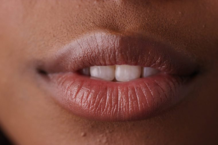 Extreme close up of sensual black woman's lips on green screen