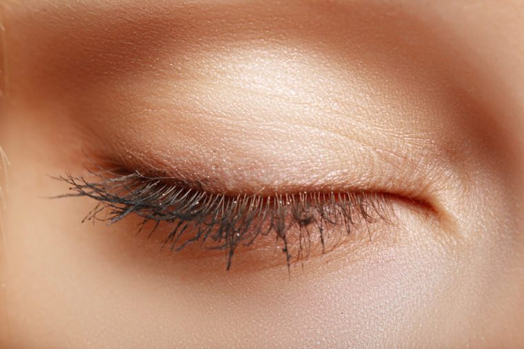 extreme closeup of beautiful womanish closed eye macro