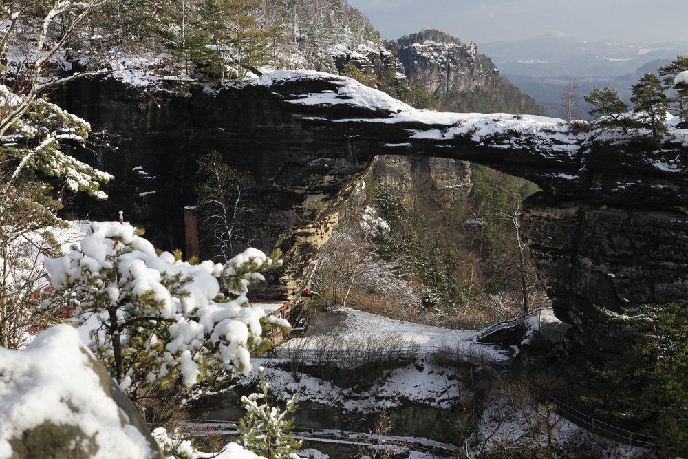 Winter landscape with rock Pravcicka brana in Czech republic
