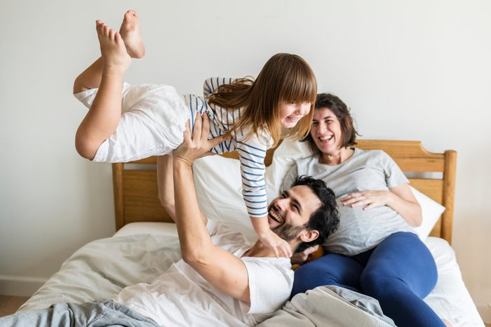 Pregnant family spending time together
