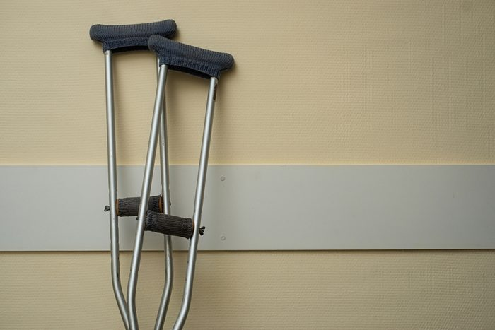 Crutches stand near the wall in the hospital