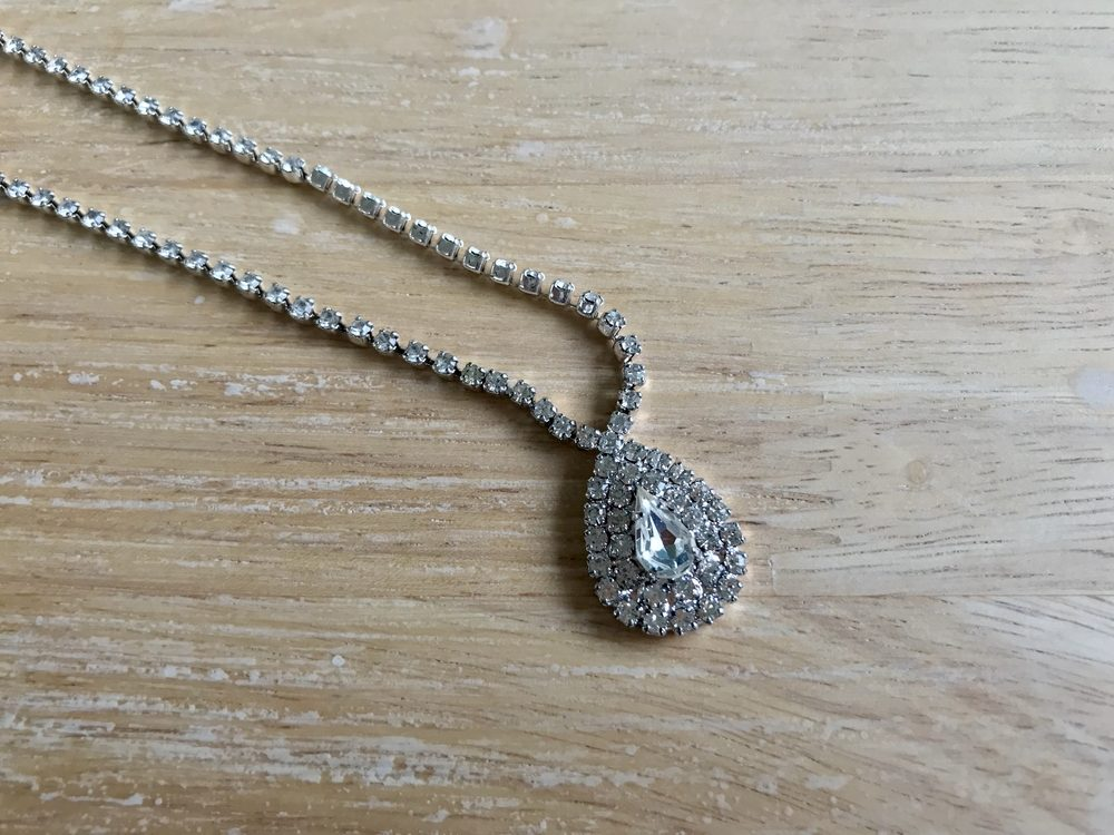 Necklace on wood floor