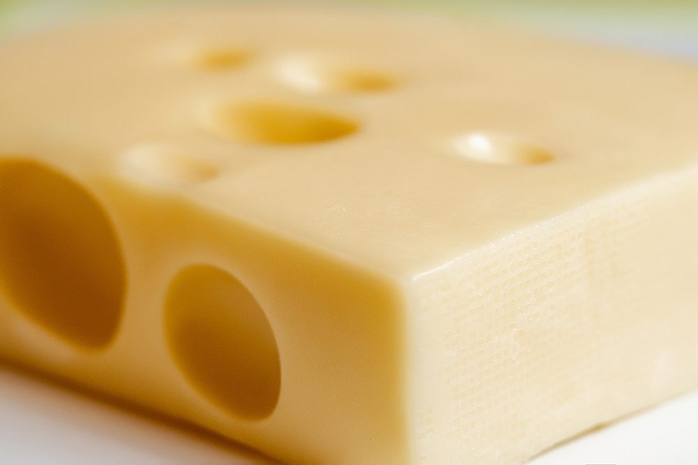 Cheese block macro isolated on white background cutout