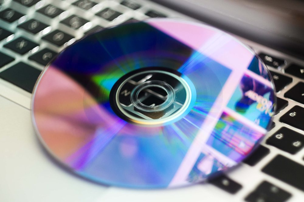 dvd disc isolated on computer keyboard. cd disc isolated.