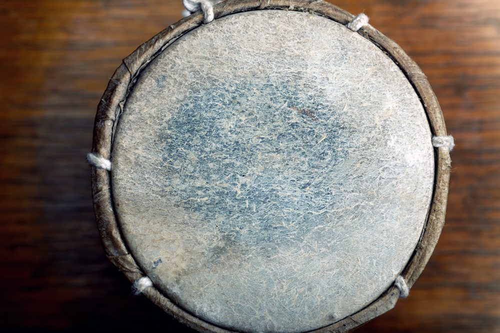 Old leather drum. Top view on the surface. Horizontal photo with shallow depth of field
