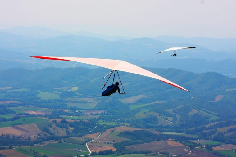 Hang glider flying in the Italian mountains